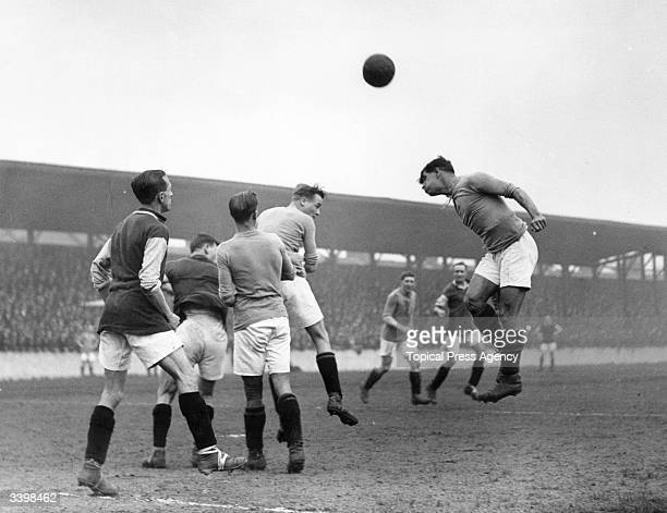 Players compete for the ball in the air as West Ham United play Crystal Palace at Upton Park