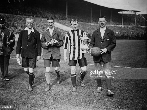 Newcastle United captain Frank Hudspeth with the FA Cup trophy after Newcastle's 20 victory over Aston Villa in the FA Cup final at Wembley Stadium...