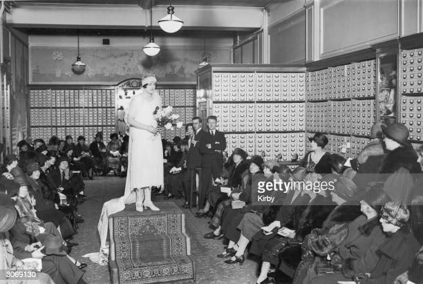 Miss Diane Furse daughter of General Sir William Furse models a bridal gown at the Mannequin Parade held at Messrs Lennards Showrooms Regent Street...