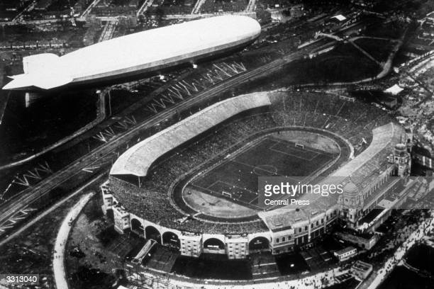 An aerial view of the Graf Zeppelin flying over Wembley Stadium in London during the 1930 FA Cup Final