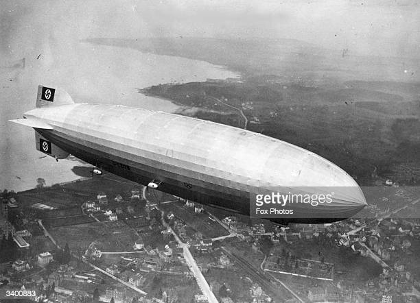 Over 800 feet long the German airship Hindenburg runs a sceduled transatlantic service between Friedrichshafen Germany and Lakehurst New Jersey...