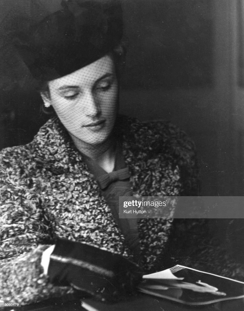 Miss Jo Crankshaw wearing a pill-box hat and an astrakhan jacket applying for a job at a models' agency. Original Publication: Picture Post - 124 - Models For Hire - pub. 1939
