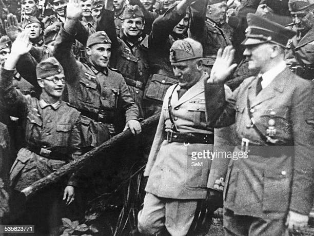 April 1944 Benito Mussolini and Adolf Hitler acclaimed by German soldiers during a visit by Italian dictator in Germany Benito Amilcare Andrea...