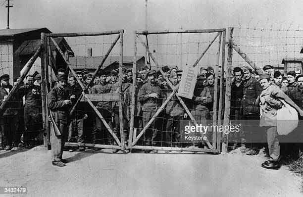 Russian inmates crowded round the gates at Wobbelin Concentation Camp