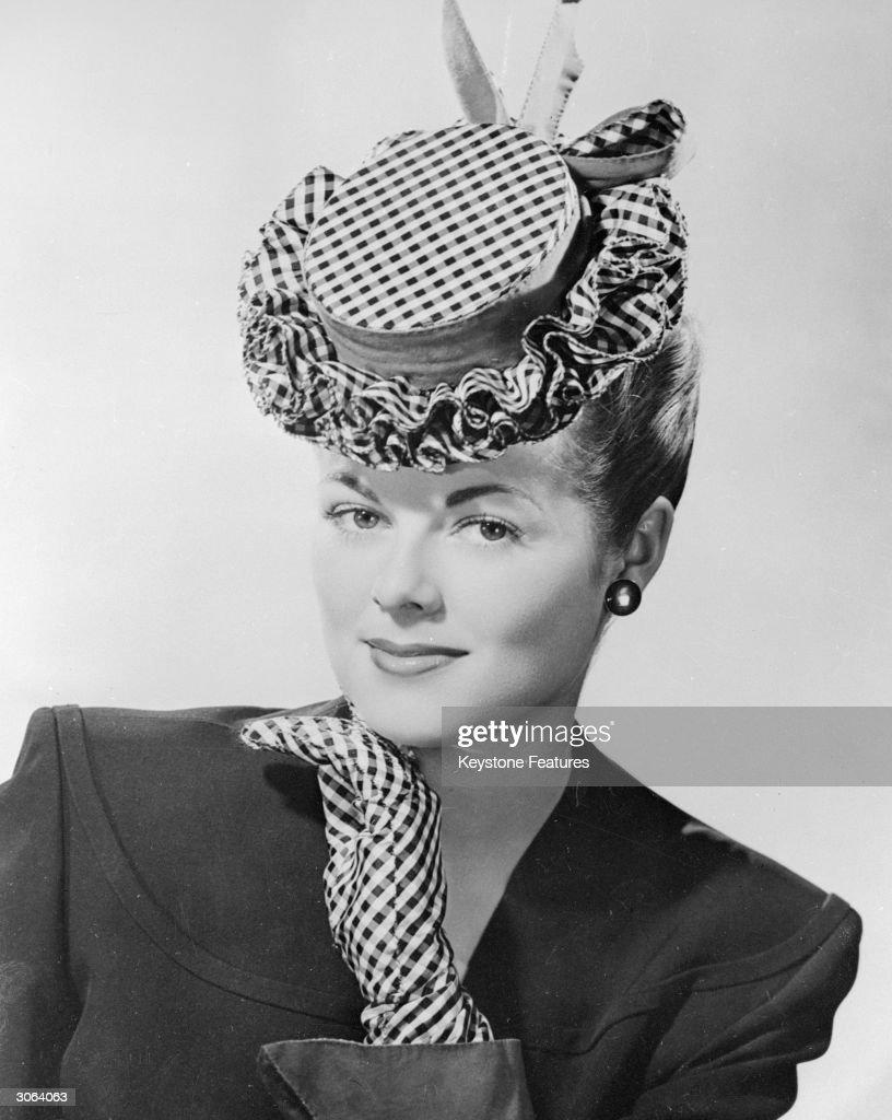A checkered taffeta hat with a petticoat ruffle brim