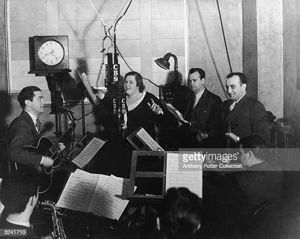 American singer Kate Smith performs with studio musicians on a radio broadcast