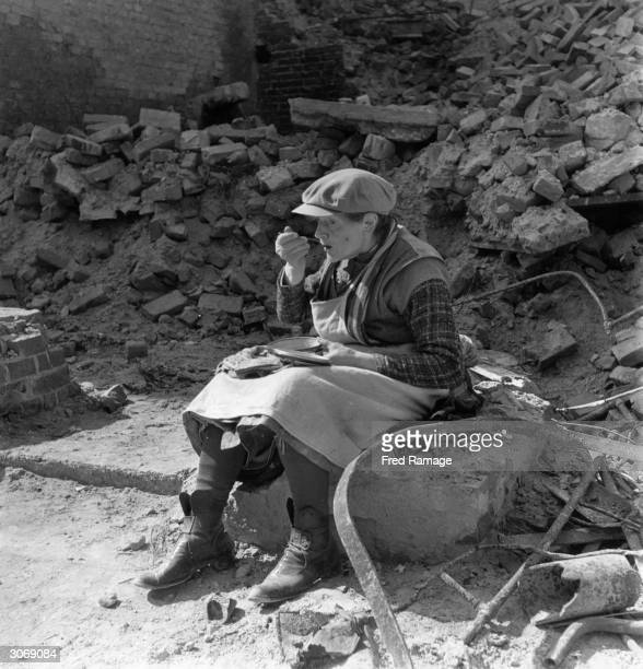 An old woman eating her lunch in the rubble of Berlin