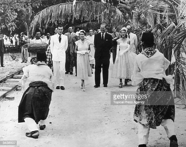 Queen Elizabeth II and the Duke of Edinburgh are presented with a Welcome Dance as they arrive at the Cocos Islands for a short visit They are with...