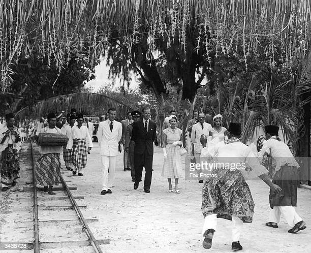 Queen Elizabeth II and the Duke of Edinburgh are presented with a Welcome Dance as they arrive at the Cocos Islands for a short visit during their...