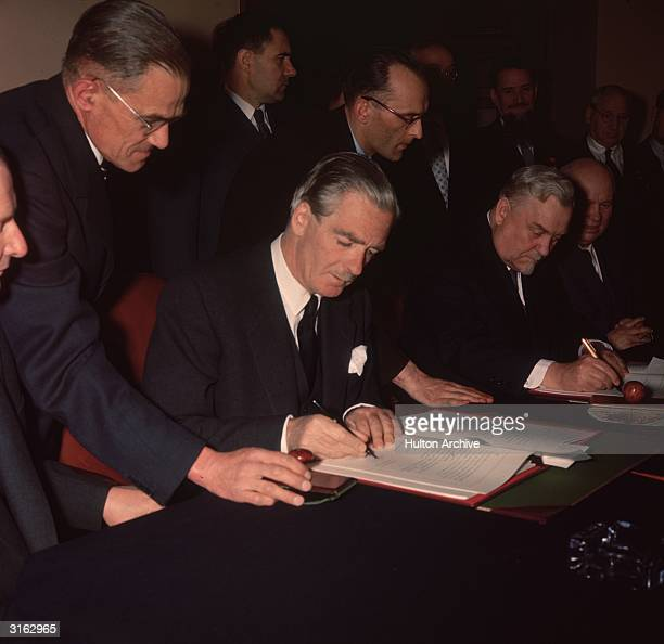 Conservative Prime Minister Sir Anthony Eden signing the Russian Agreement in London Also signing on his left is Russian Premier Nikolai Bulganin...