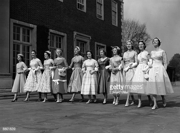 A line of American debutantes gathered at the American Ambassador's residence in Regent's Park London before leaving for Buckingham Palace to be...