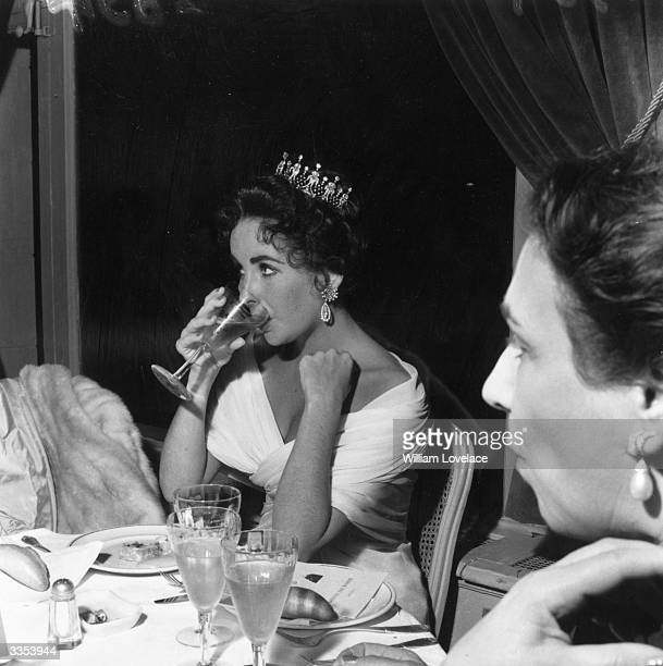 Actress Elizabeth Taylor dining at the Cannes Film Festival