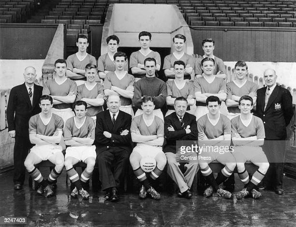 The Manchester United team group Webster Wilf McGuinness Jackie Blanchflower Doherty Coeman trainer Tom Curry Bill Foulkes Bobby Charlton Goodwin Ray...