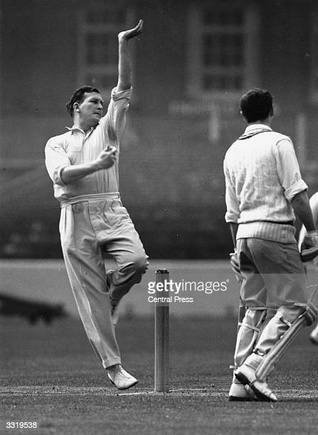 English cricketer Jim Laker in action for Surrey