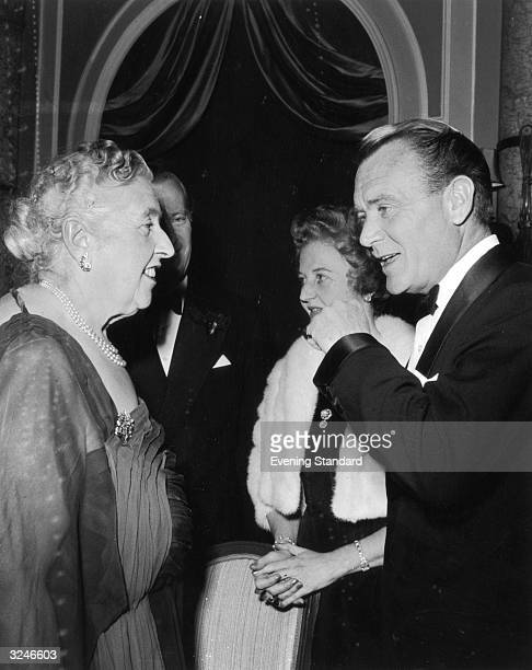 Mystery writer Agatha Christie welcomes actor John Mills and his wife Mary Hayley Bell to a party at the Savoy Hotel to celebrate the 2239th...