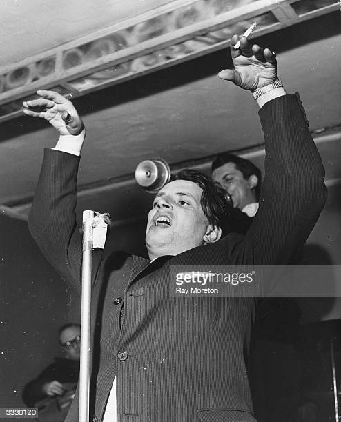 Jazz singer George Melly during a performance at a night club He is singing with the Mick Mulligan jazz band