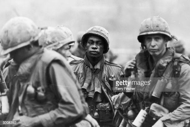 A group of US marines with grenades waiting to take part in the movement on Khe Sahn Command Post 'Stud' during the Vietnamese conflict 1968