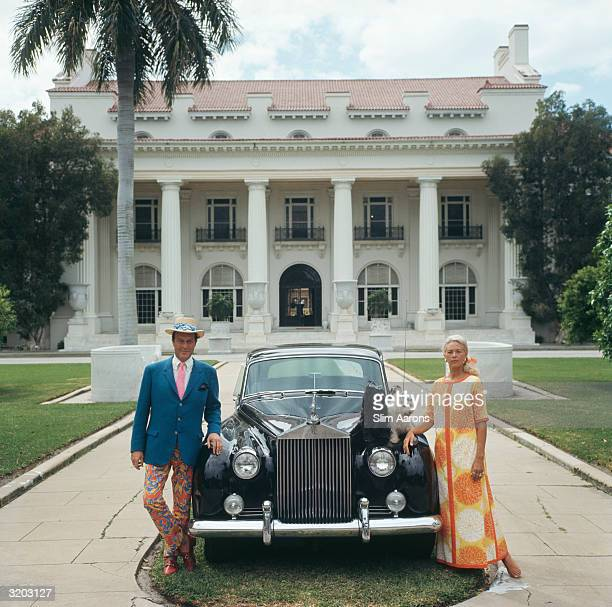 Mr and Mrs Donald Leas with their Rolls Royce and two pet dogs outside The Flagler Museum in Palm Beach Florida