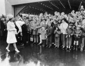 Queen Elizabeth II greets a crowd at Hobart Tasmania during a royal tour