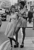 Models Endy Cartnell in a spotted sundress and hat and Selina in a striped sundress and bolero with 1950's jewellery in the King's Road Chelsea...