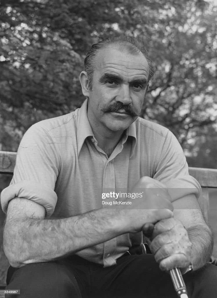 British actor, Sean Connery taking a break during a game of golf.