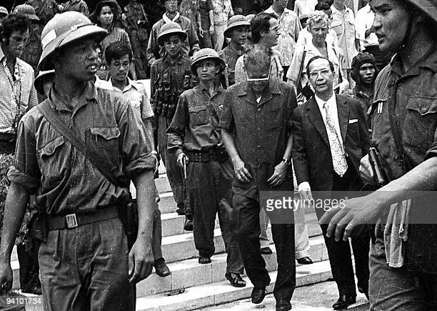 A 30 April 1975 photo shows Duong Van Minh the last president of USback Saigon regime and his entourage leaving the presidential palace in Saigon 30...