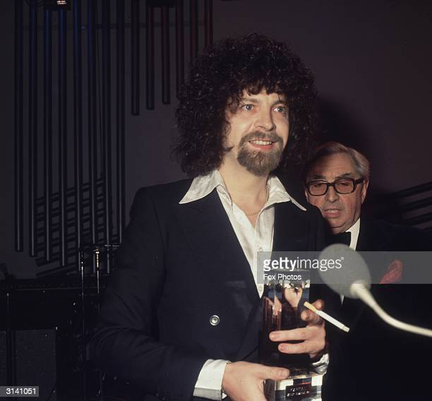 Pop musician composer and producer Jeff Lynne of the ELO accepts his prize from exMP Lord George Brown at the Capital Radio Music Awards held at...