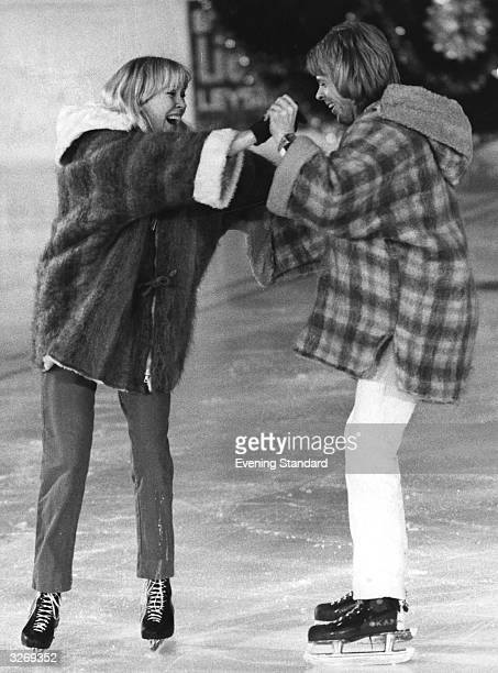 Abba singers husband and wife Bjorn Ulvaeus and Agnetha Faltskog skating at Leysin Sports Centre icerink during the filming of Abba's first...