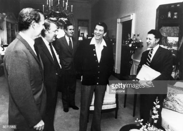 American statesman Ronald Reagan 40th president of the United States at a cabinet meeting in the family quarters of the White House Washington DC...