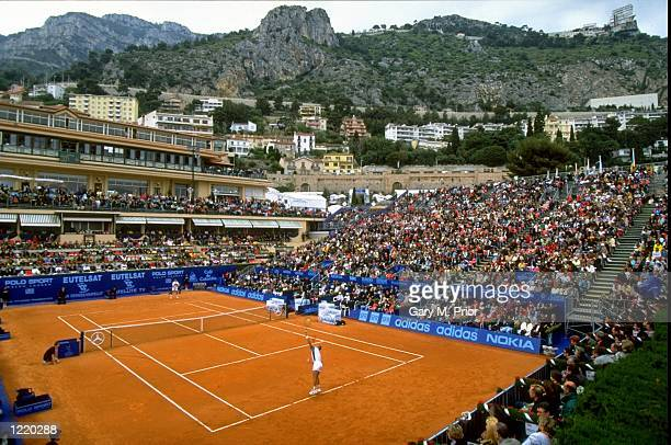 General view of a court surrounded by spectators during the Monte Carlo Open in Monaco Mandatory Credit Gary M Prior/Allsport
