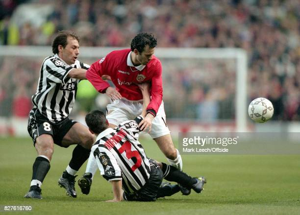 UEFA Champions League Semi Finals 1st Leg Manchester United v Juventus Antonio Conte and Zoran Mirkovic of Juventus combine to tackle Ryan GiggsPhoto...