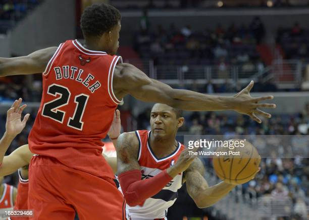 Washington Wizards shooting guard Bradley Beal looks to pass against Chicago Bulls small forward Jimmy Butler on April 2 2013 in Washington DC