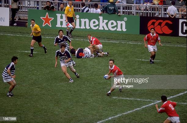 Singapore and Japan in action during the IRB World Sevens Series 2001 Hong Kong Sevens tournament held at the Hong Kong Stadium in Hong Kong...
