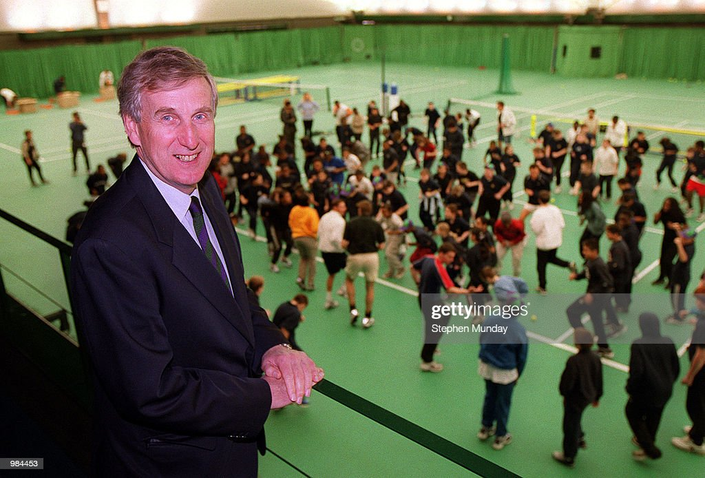 Tim Phillips of England Chairman of the All England Club with children from Battersea Tech College on the indoor courts at the All England Club in Wimbledon to announce a new junior tennis initiative ' The Road To Wimbledon' organised bythe All England Club. Mandatory Credit: Stephen Munday/ALLSPORT