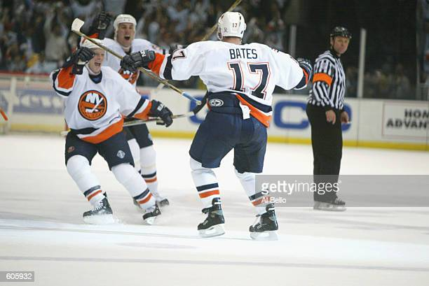 Shawn Bates of the New York Islanders celebrates his winning goal against the Toronto Maple Leafs during game four of the Stanley Cup playoffs at the...
