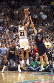Tim Duncan of the San Antonio Spurs Spurs shoots the winning game shot over Dirk Nowitzki of the Dallas Mavericks during the 4th quarter of the game...