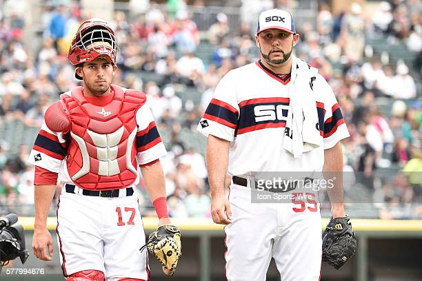 Battery mates Adrian Nieto and Chicago White Sox starting pitcher Felipe Paulino make their way to the dugout prior to a game between the Cleveland...