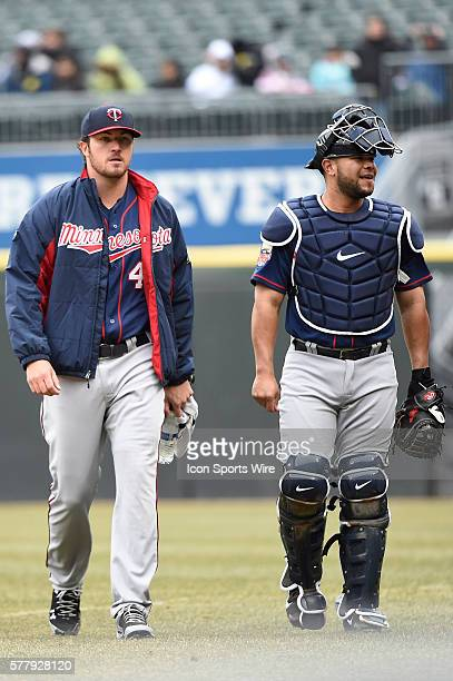 Battery mates Josmil Pinto and Phil Hughes make their way to the Twins dugout prior to playing in MLB game pitting division rivals the Minnesota...