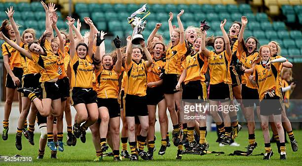 5 April 2014 Coláiste Íosagáin team captain Aedini Ni Dhonaill lifts the cup as her teammates celebrate TESCO HomeGrown Post Primary School Senior A...