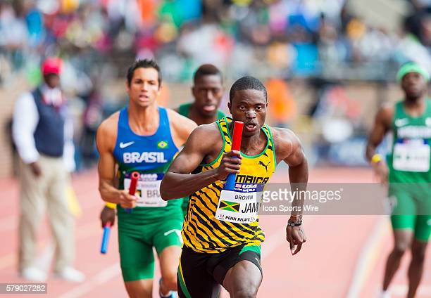 Jermaine Brown heads into turn one of the fourth leg of the USA vs the World Men 4x400 during the Penn Relays at Franklin Field in Philadelphia...