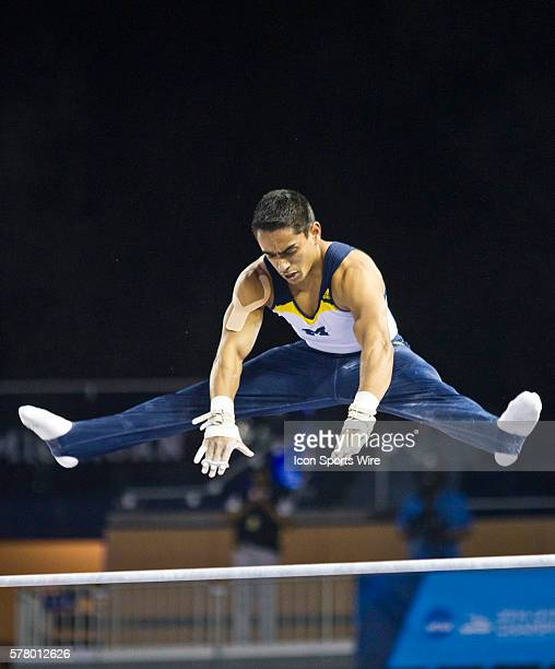 Michigan's Syque Caesar competes in the horizontal bar event during individual event finals at the 2014 national collegiate men's gymnastics...