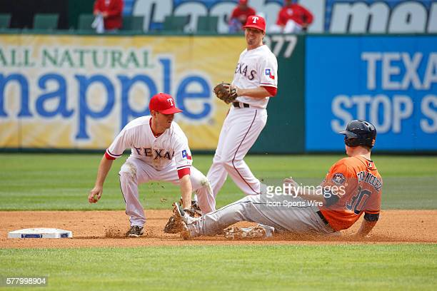 Texas Rangers second baseman Josh Wilson tags out a sliding Houston Astros third baseman Matt Dominguez during the MLB baseball game between the...