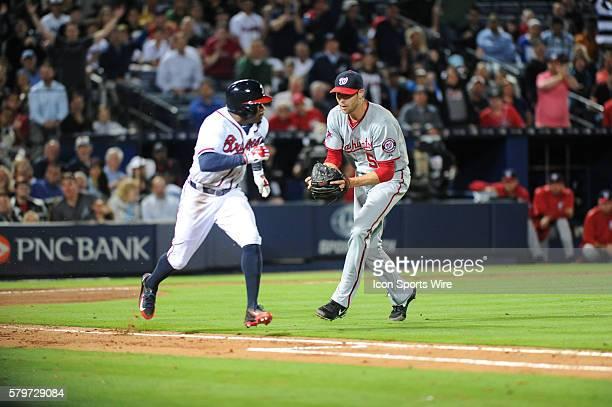 Atlanta Braves Outfield Eric Young Jr lays downa sacbunt during a regular season game between the Washington Nationals at Atlanta Braves game at...