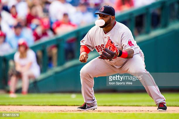 Boston Red Sox third baseman Pablo Sandoval stands at the ready while he blows a bubble with chewing gum during the MLB game between the Boston Red...