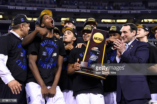 Duke Blue Devils head coach Mike Krzyzewski celebrates with his players by watching a video after the trophy ceremony in action during the NCAA...