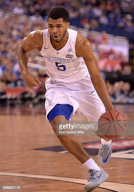 Kentucky guard Andrew Harrison drives the ball during a NCAA Final Four game between the Wisconsin Badgers and the Kentucky Wildcats at Lucas Oil...