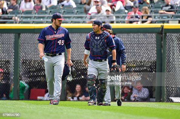 Minnesota Twins starting pitcher Phil Hughes and Minnesota Twins catcher Kurt Suzuki leaving the bull pen prior to playing in a MLB game between the...