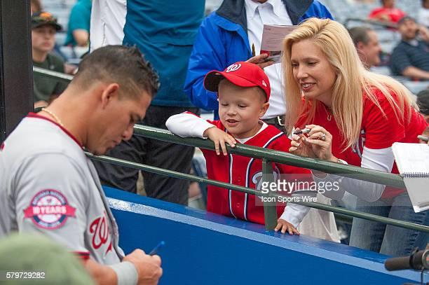 Washington Nationals Catcher Wilson Ramos signing autographs before a regular season game between the Washington Nationals at Atlanta Braves game at...