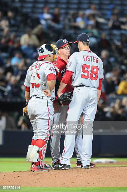 Washington Nationals Starting pitcher Doug Fister gets a visit from Washington Nationals Pitching Coach Steve McCatty during a regular season game...