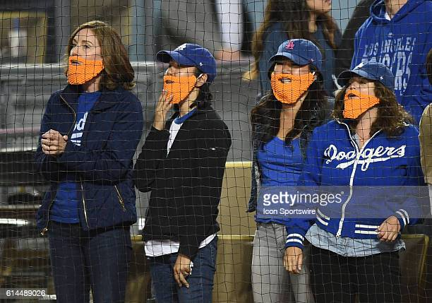 Dodgers fans wear mock Justin Turner beards in support of his Chia Pet night during an MLB game between the San Diego Padres and the Los Angeles...